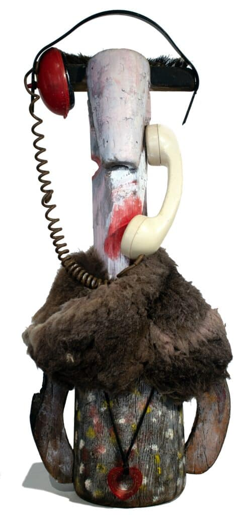 Murray Walker<br><em>Yak, Yak on the phone</em>, 1993 - 1994<br>Painted wood, various found object assemblage<br>48 cm by 11 cm by 7 cm<br>$6,750