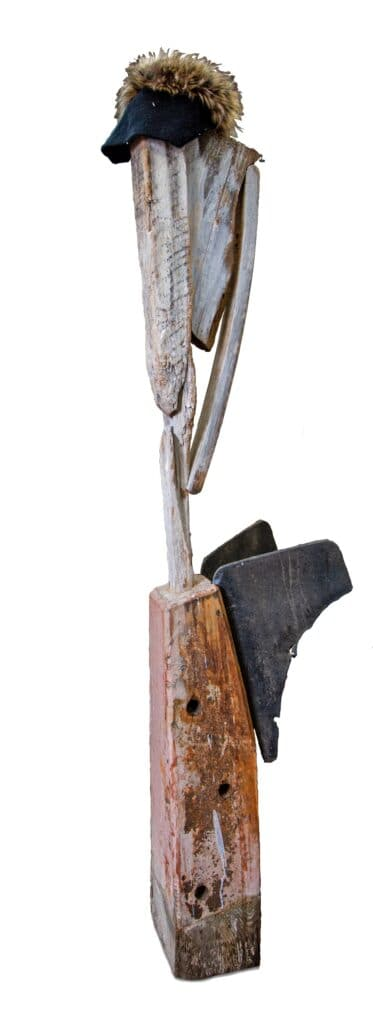 Murray Walker<br><em>The Angel with The Wings</em>, 1997<br>Foudn timber, car mudflaps and various objects assemblage<br>167 cm by 22 cm by 37 cm<br>$4,750